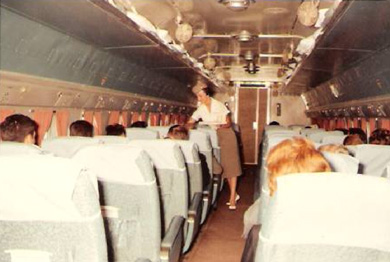 Nancy Rogers on the DC-4. Note the fans on the overhead racks.